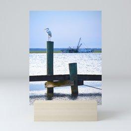 the egret and the shipwreck Mini Art Print
