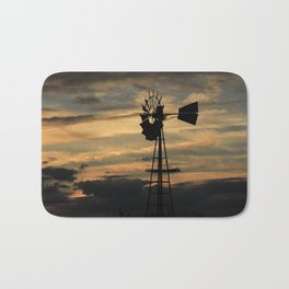 Kansas Sunset with a Windmill Silhouette with Clouds Bath Mat