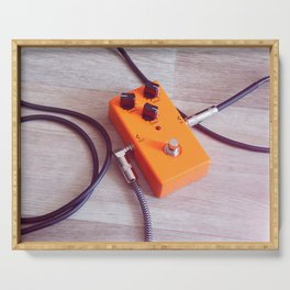 orange pedal effect and black cables on wooden floor. toning Serving Tray