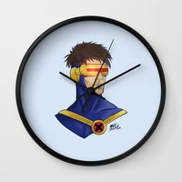 cyclops Wall Clocks featuring Cyclops by Matthew Bartlett