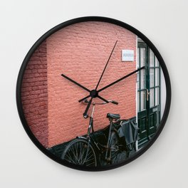 Dutch bike in front of colorful wall || Travel photography pink red architecture minimalism city cityscape house Wall Clock