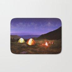Illuminated yellow camping tent under stars at night Bath Mat