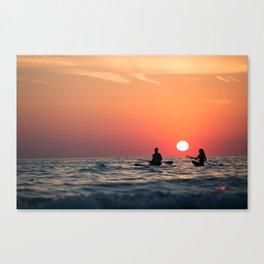 man woman boat rowing in sea Canvas Print