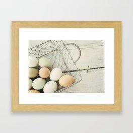 Eggs in one basket Framed Art Print