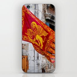 Colors of Venezia, golden-red flag, old building at background iPhone Skin