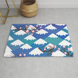 Spring Nature background with Japanese cherry blossoms, sakura pink flowers landscape. blue mountain Rug