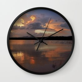 Sunset at the lake after the storm. Wall Clock