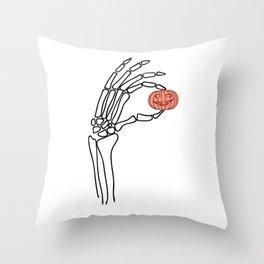 Halloween skeleton hand with pumpkin Throw Pillow