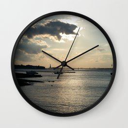 Lady Liberty in the Distance at Sunset Wall Clock