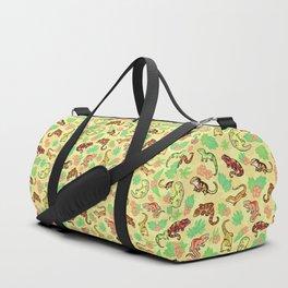 Gecko family in yellow Duffle Bag