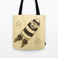 rocket Tote Bags featuring rocket by Mariana Beldi