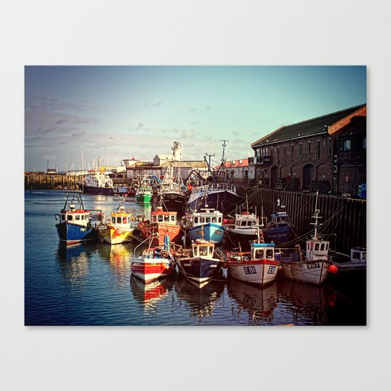 Boats resting in the Harbour Canvas Print