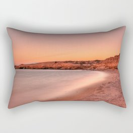 Sunset at a wild beauty beach with eaten by the sea cliffs and unique caves in Karpathos, Greece Rectangular Pillow