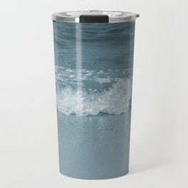 Wave splashing on a beach Travel Mug