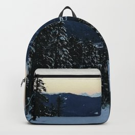 Snowboarding downhill at sunset Backpack