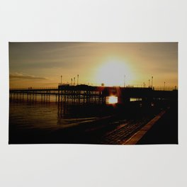sundown at the pier Rug