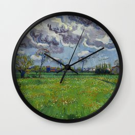 Meadow With Flowers Under a Stormy Sky Wall Clock