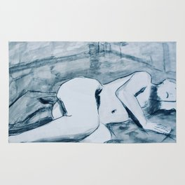 In the studio- charcoal and ink nude study of model reclining. Rug