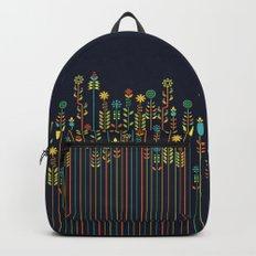 Overgrown flowers Backpacks