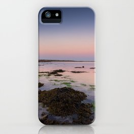 Dog chasing fish in Barna, Ireland iPhone Case