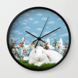 White lop eared bunny in a flower garden Wall Clock