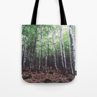 uncharted Tote Bags featuring Uncharted Woods  by Oscar Goodwin