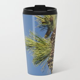 Pine cones and branches against a blue autumn sky Travel Mug