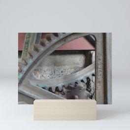 Cogs, wheels and rusty machinery Mini Art Print