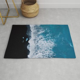 Abstract and minimalist black sand beach in Iceland with chunks of Ice and waves - moody Landscapes Rug