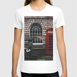 TIME LAPSE PHOTOGRAPHY OF WOMAN WALKING ON STREET WHILE HOLDING UMBRELLA NEAR LONDON TELEPHONE BOOTH BESIDE WALL T-shirt