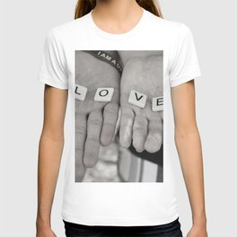 Love- a couple holding tiles spelling T-shirt
