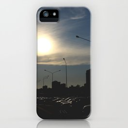 The bright sun in the clear sky illuminates many cars parking near road in the sleeping area iPhone Case