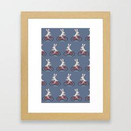 Bunny riding bike Framed Art Print