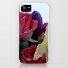 Vibrant bouquet of flowers in the snow iPhone Case