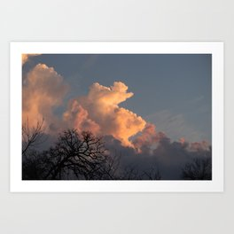 the clouds seem to mimic the treeline. Art Print
