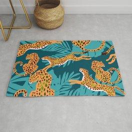 leopards in tropical forest - orange and dark blue Rug