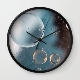 Colorful abstract background with oil drops on water. Earth color Wall Clock