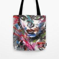 third eye Tote Bags featuring third eye by yossikotler
