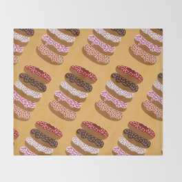 Stacked Donuts on Yellow Throw Blanket