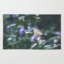 Butterfly on the wild purple flowers Rug