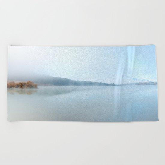 """Wild sunrise"". Foggy lake Beach Towel"