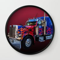 optimus prime Wall Clocks featuring Optimus Prime Red by Steve Purnell