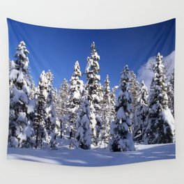 Snow covered trees in the forest. Winter day with blue sky. Wall Tapestry