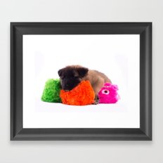 Puppy with colored toys Framed Art Print