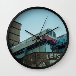 Trains in the city Wall Clock