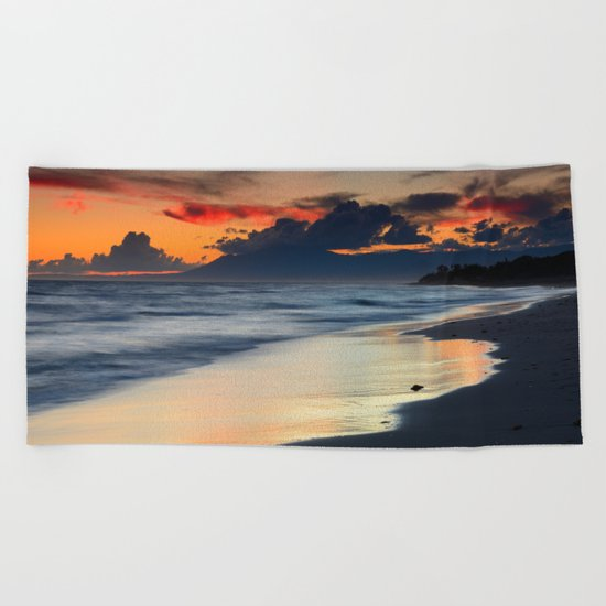 Magic red clouds. Sea dreams Beach Towel