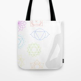 Chakra icons in respective colors with meditating person Tote Bag