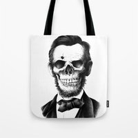 lincoln Tote Bags featuring Lincoln Skull by BIOWORKZ