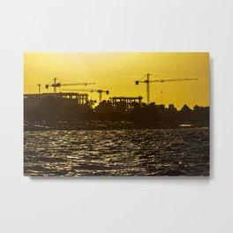 Cranes of a construction workshop at Izmir (Turkey) during sunset Metal Print