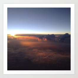 Sunsetting in clouds Art Print
